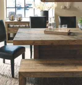 Wood dining room table in brown color