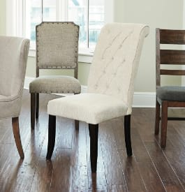 Fabric and wood dining chairs in white, gray, and brown colors